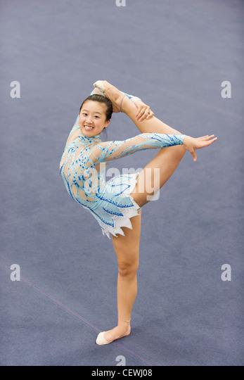Female gymnast performing floor routine - Stock Image