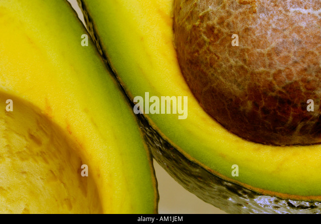 Cut open avocado - Stock Image