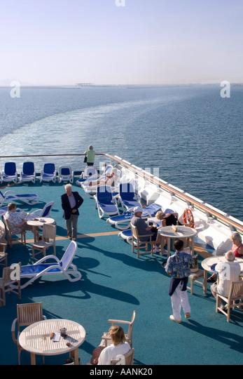Passengers on a Cruise Ship leaving Cagliari, Sardinia, Mediterranean Sea Europe - Stock Image