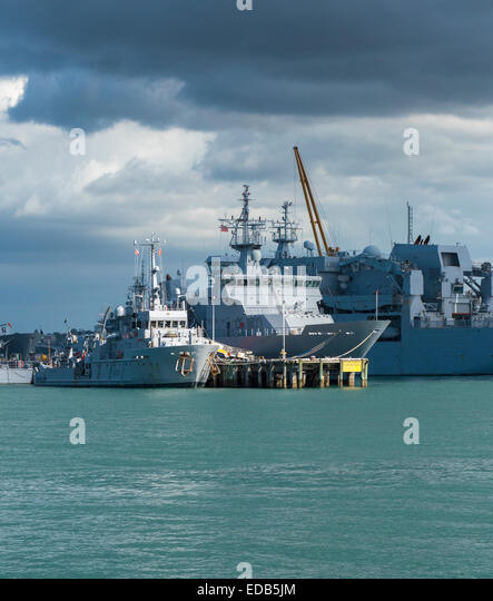 Ships of the Royal New Zealand Navy moored at Devonport Naval Dockyard in Waitemata Harbour, Auckland New Zealand - Stock Image