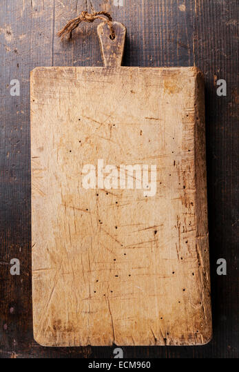 Chopping cutting board on dark wooden background - Stock Image