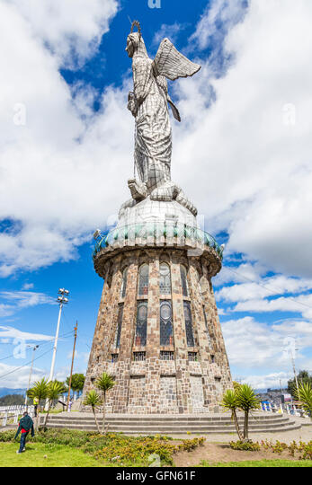 The iconic Virgin of Quito statue, Quito, capital city of Ecuador, South America with blue sky and clouds on a sunny - Stock Image