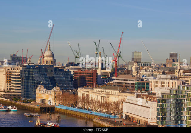 City of London skyline dotted with cranes and the dome of St Paul's Cathedral London England Europe - Stock Image