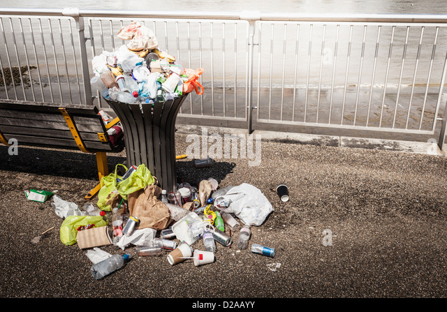 Trash overflowing from bin - Stock Image