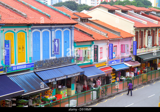 Singapore Little India Buffalo Road two-story storey shophouses shophouse red clay tile roof businesses - Stock Image