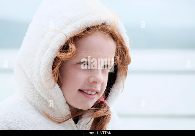 Portrait of a girl on a windy coastline. - Stock Image