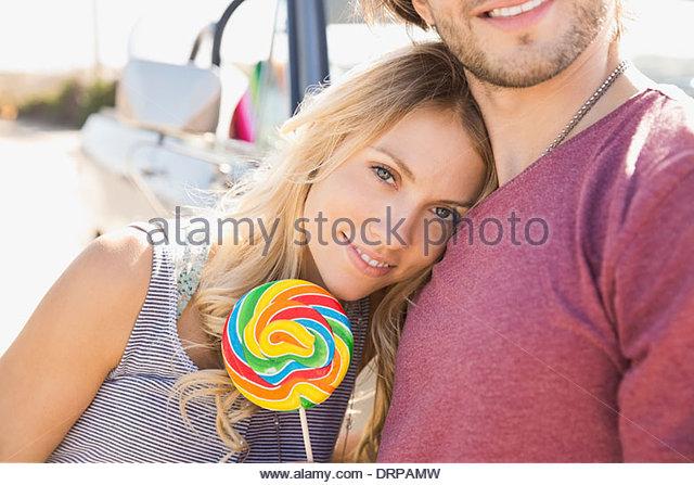 Beautiful woman holding a lollipop - Stock Image