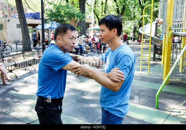 Lower Manhattan New York City NYC NY Chinatown Seward Park public park playground Shuai Jiao Chinese Wrestling sport - Stock Image