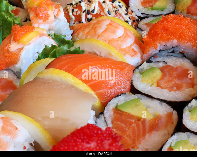 Japanese sushi close up with a variety of delicious prepared fresh raw fish and seafood as salmon shrimp and caviar - Stock-Bilder