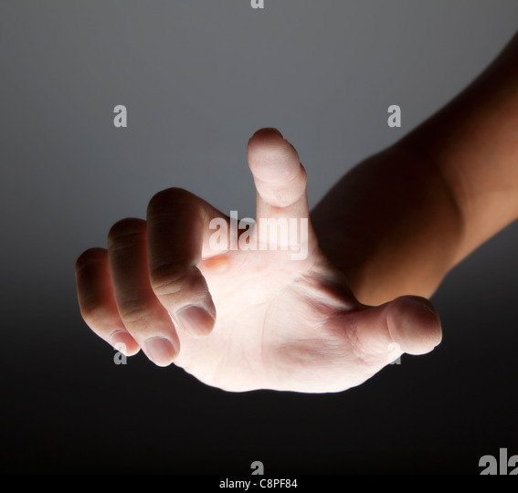hand touching in the dark - Stock-Bilder