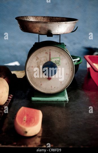 Scales and fruit in Bangkok, Thailand - Stock Image