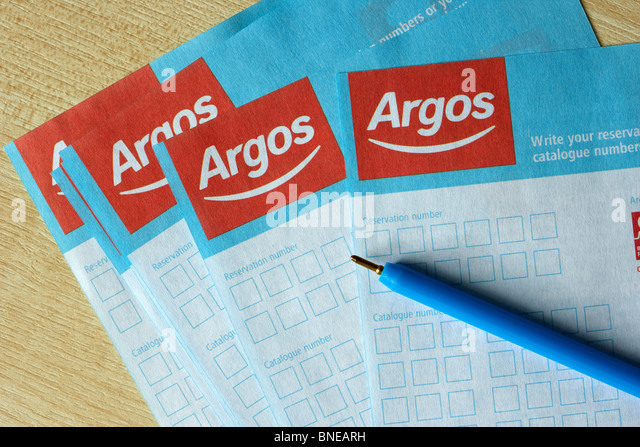 Argos reservation or catalogue number order forms with pen - Stock Image