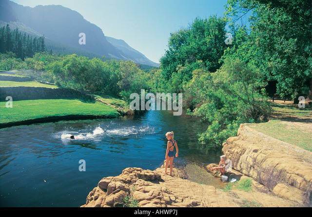 Swimming in a pool at Algeria Camp Cedarberg Wilderness Area South Africa - Stock Image