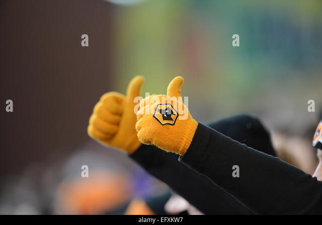 Supporter of Wolverhampton Wanderers giving a thumbs up sign - Stock-Bilder