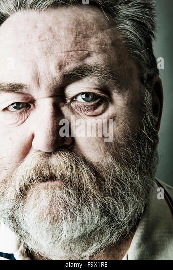 Portrait of senior man with full beard, close-up - Stock Image
