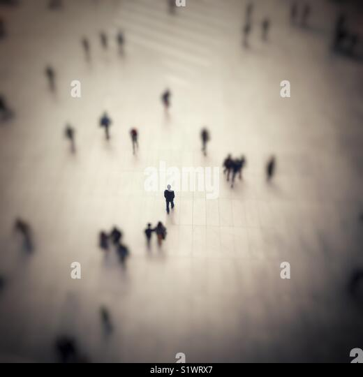 A lone man in focus at the World Trade Center PATH Station. - Stock Image