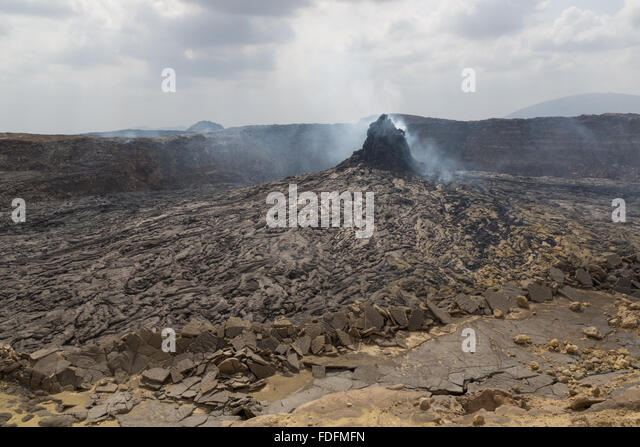 A steaming Hornito lies at the center of a sunken crater inside the main caldera of Erta Ale volcano, Ethiopia - Stock Image