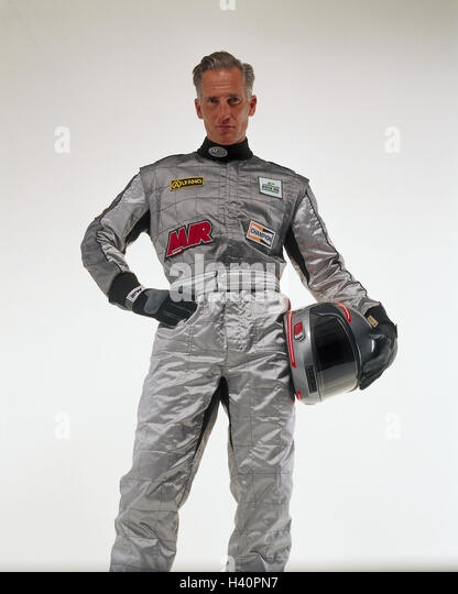 Motor sport, racing driver, overall, helmet, silver sport, racing sport, man, racing suit, crash helmet, safety - Stock Image