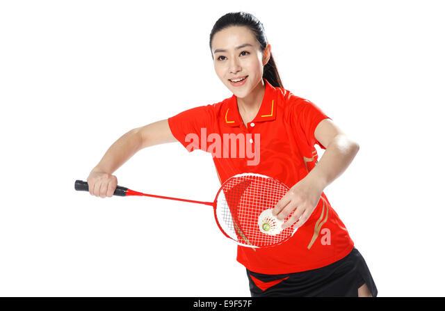 Athletes playing badminton - Stock Image