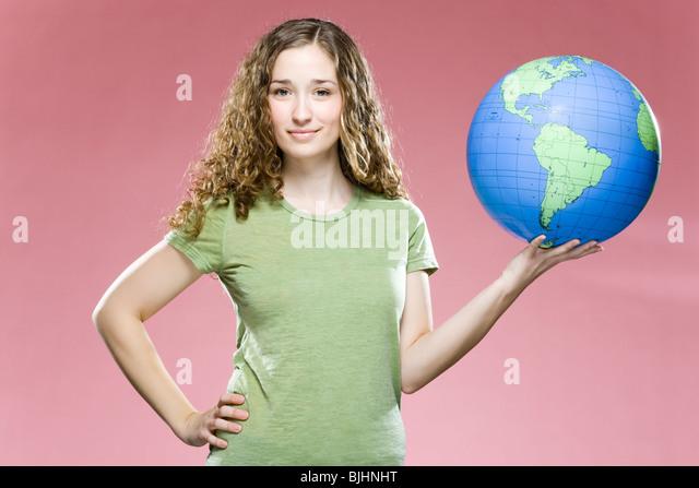 woman holding a globe - Stock Image