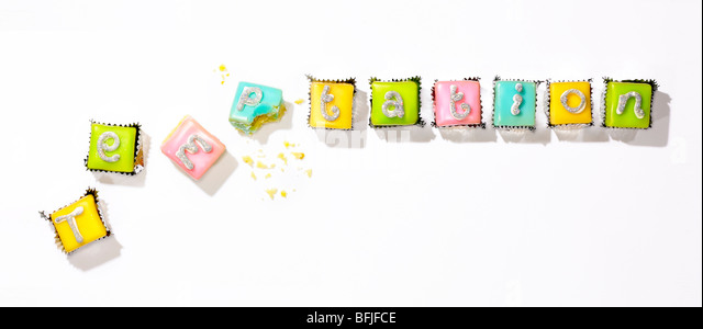 small cakes to illustrate the word temptation - Stock Image