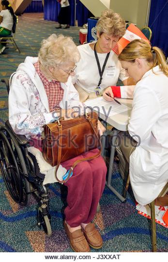 Miami Florida James L. Knight Center centre Women's Heart Health Fair Sister to Sister Foundation heart disease - Stock Image