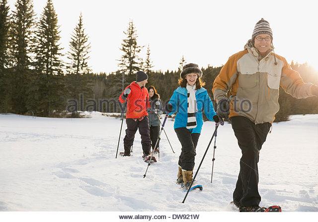 Multi-generation family snowshoeing - Stock-Bilder