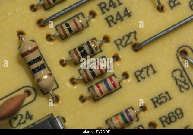 Macro-photo of carbon resistors on a printed circuit board (PCB). - Stock Image