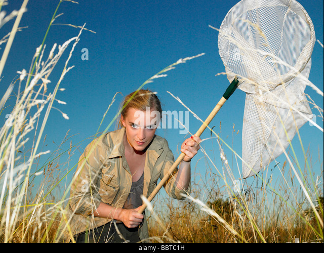 Woman with butterfly net - Stock-Bilder
