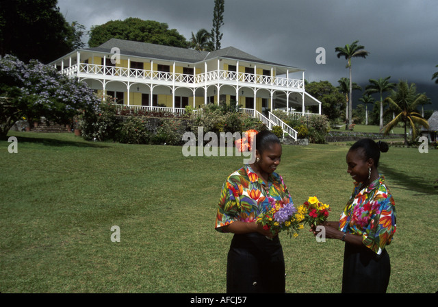West Indies St. Kitts Ottley Plantation Inn 18th century sugar plantation two Black female employees flowers - Stock Image