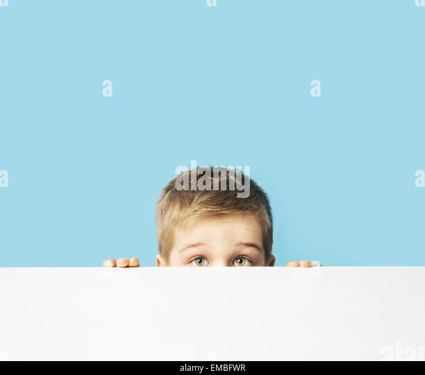 Portrait of the small shy kid - Stock Image