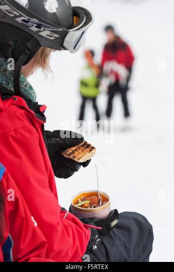 Sweden, Stockholm, Bjorkhagen, Hammarbybacken, Woman holding bowl with meal - Stock Image