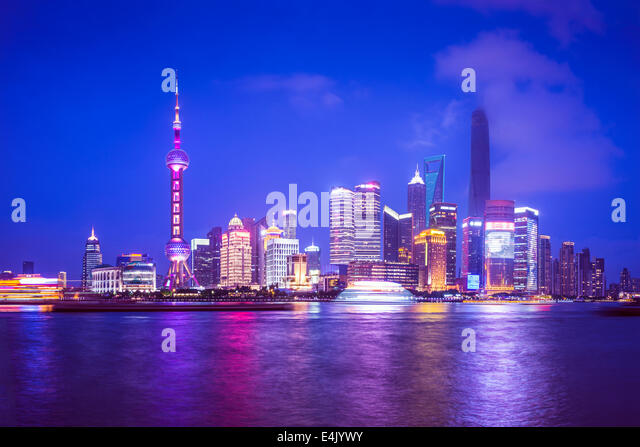 Shanghai, China view of the Pudong financial district from across the Huangpu River at night. - Stock Image