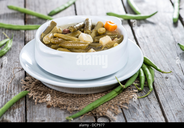 Homemade Green Bean Stew on vintage wooden background - Stock Image