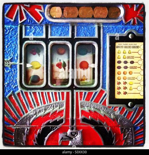 Retro slot machine with fruit symbols and a bold colourful design. - Stock Image