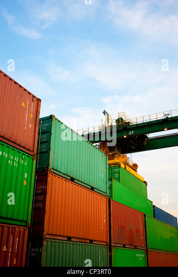 Cargo containers at dusk - Stock Image