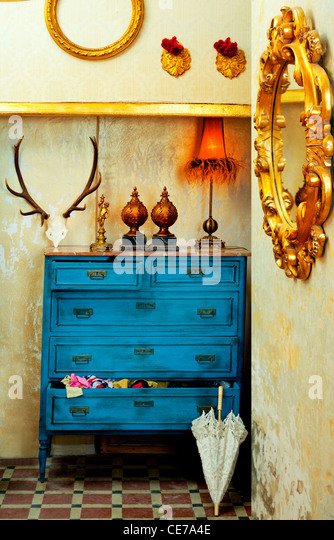 baroque grunge vintage house with blue drawer and golden mirror - Stock-Bilder
