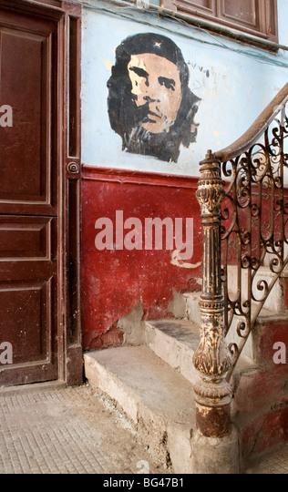 Che Guevara mural in the old building/ entrance to La Guarida restaurant, Havana, Cuba, Caribbean - Stock Image