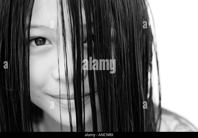Portrait of a young Oriental girl smiling - Stock Image