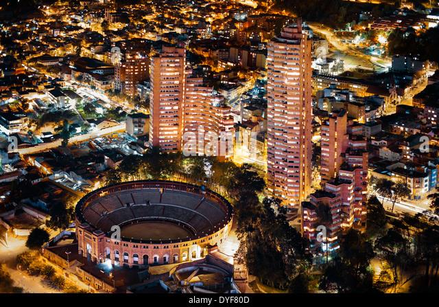 Santamaría Bullring (Plaza de Toros de Santamaría) in Bogotá, Colombia. Aerial view at night. - Stock Image