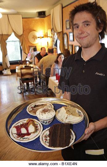 Arkansas Eureka Springs Ermilio's Italian Home Cooking restaurant dining food tables waiter plate dessert cake - Stock Image