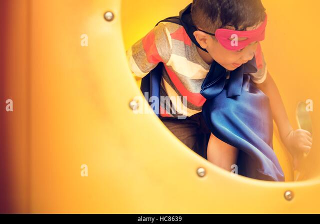 Playground Yard Superhero Freedom Child Boy Concept - Stock Image