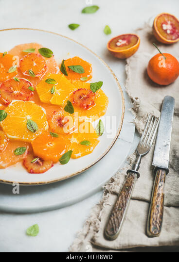 Vegetarian Fresh mixed citrus fruit salad with mint and honey - Stock Image