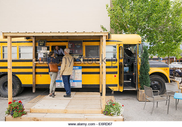 Older couple ordering at food truck - Stock-Bilder