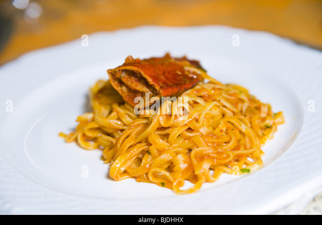 Fettuccine pasta with lobster sauce - Stock Image