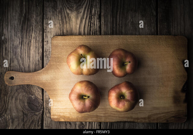Red apples on a cutting board horizontal - Stock Image