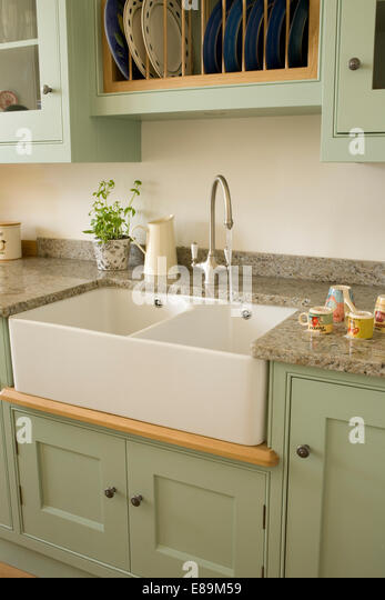 Belfast Sink Stock Photos amp Belfast Sink Stock Images Alamy : chrome tap above double belfast sink in pale green units in country e89m59 from www.alamy.com size 347 x 540 jpeg 44kB