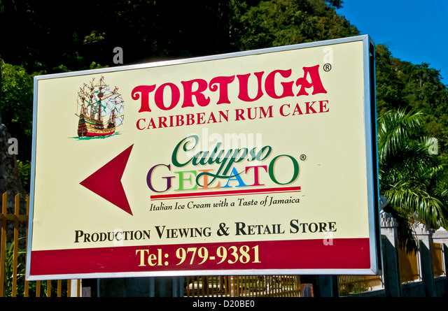 Tortuga Caribbean Rum Cake sign at the rum cake factory in Montego Bay Jamaica - Stock Image