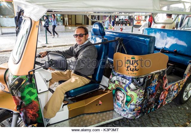 Lisbon Portugal Restauradores Square tuk auto rickshaw three-wheeled taxi man driver - Stock Image