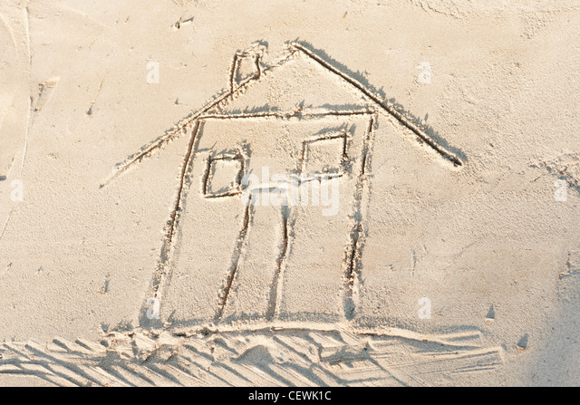 House drawn in sand, high angle view - Stock-Bilder
